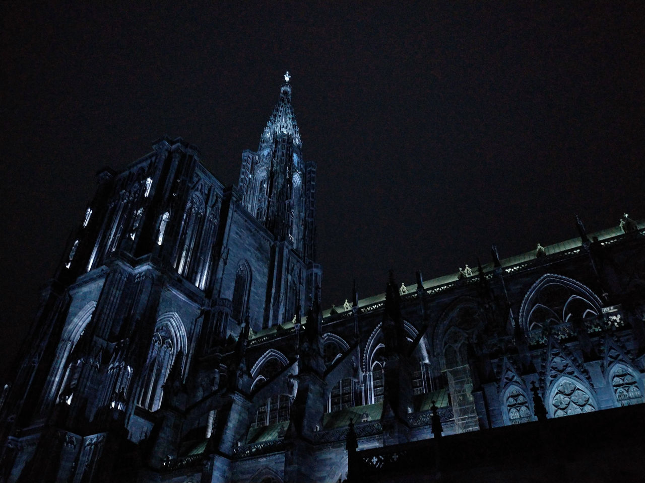 built structure, architecture, building exterior, night, building, religion, low angle view, belief, spirituality, place of worship, sky, no people, illuminated, history, the past, travel destinations, tourism, gothic style, spire