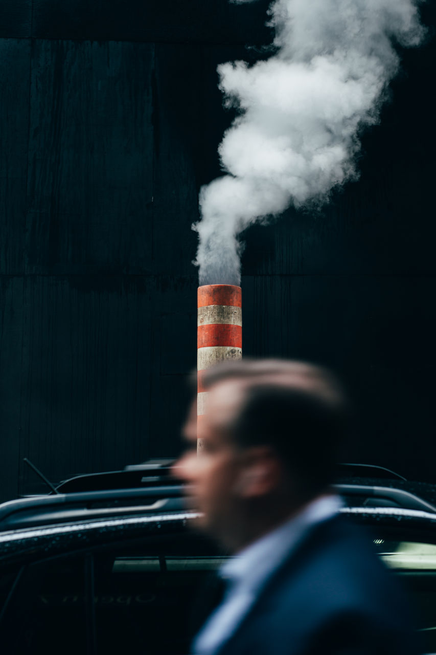 smoke - physical structure, danger, car, risk, transportation, one person, addiction, bad habit, outdoors, headshot, day, young adult, people