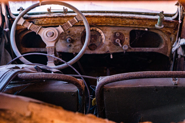 Close-up of rusty machine in car