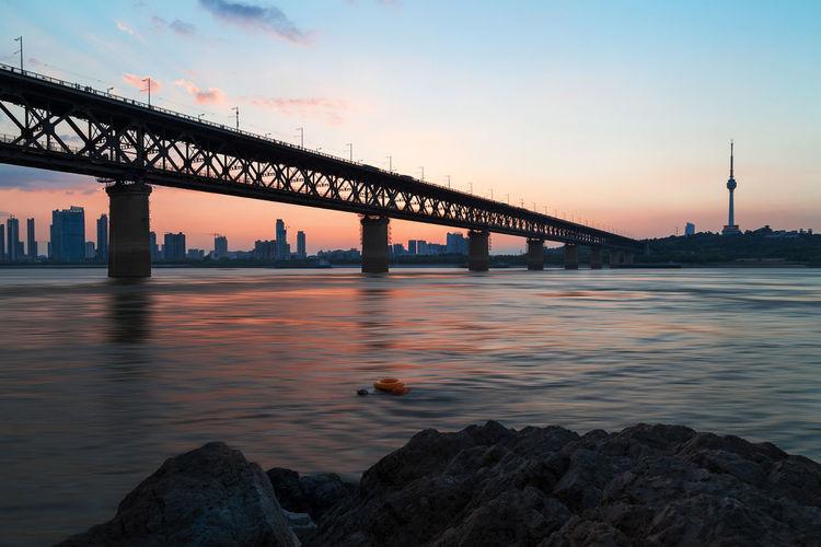 Wuhan Yangtze River Bridge Over River Against Tortoise Mountain Tv Tower