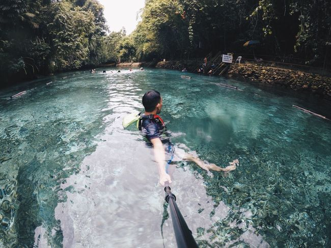 Don't look back! Real People Water Leisure Activity Lifestyles High Angle View One Person Nature Tree Outdoors Day Adventure Boys Full Length Beauty In Nature Childhood People Photooftheday EyeEmbestshots EyeEmBestPics EyeemPhilippines The Week On EyeEm Investing In Quality Of Life