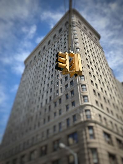 Traffic Light with Flatiron Building Exterior Low Angle View Built Structure Architecture Building Cloud - Sky No People