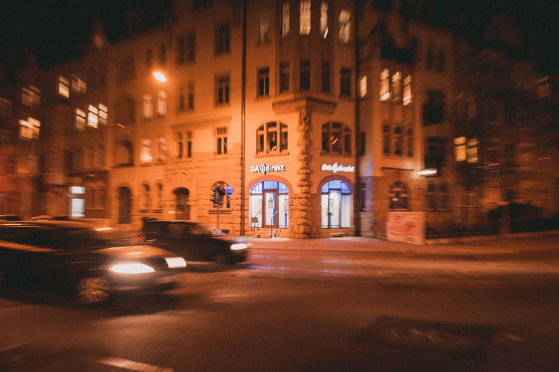 Architecture Built Structure City Building Exterior Mode Of Transportation Night Illuminated Car Motor Vehicle Land Vehicle Transportation Motion Building Street Blurred Motion No People Window Road Outdoors Residential District