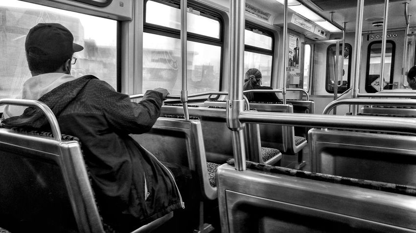 Monochrome Editorial  Black And White Real People Window Indoors  Train - Vehicle Public Transportation Men Sitting Transportation People Stories From The City