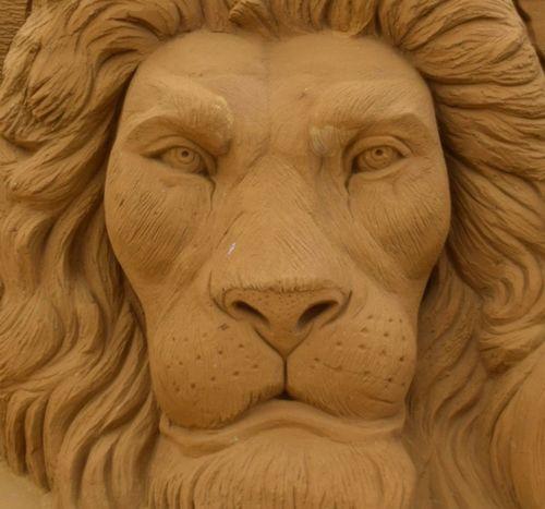Close-up sandsculpture Sandart Lion