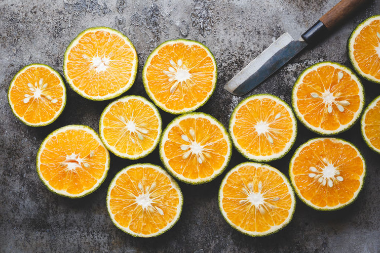 Close-up of orange fruits and knife on table