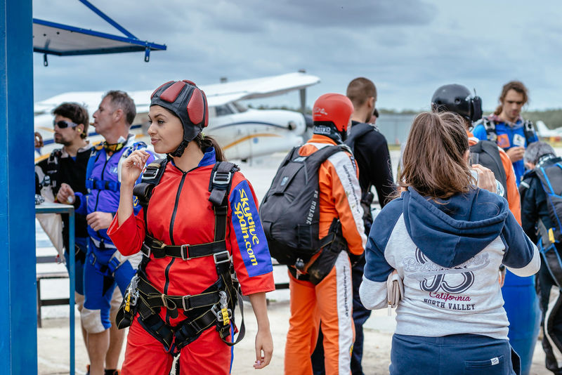 woman prepares to skydive. La Juliana Aerodrome, Seville, Spain. Adrenaline Adventure Aerodrome Altitude Club Course Cute Diver Exploring Freefall Fun Girl Hobby Instructor Jumpers  Man Parachute Sky Skydive Skydivers Skydiving Sport Training