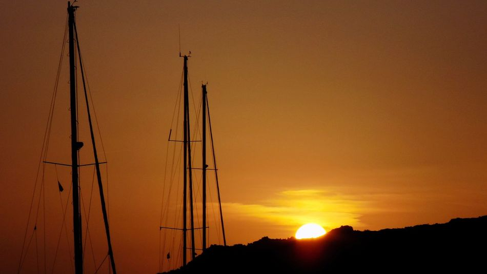 Sunset Orange Color Silhouette Nature Yellow Outdoors Scenics Sky Beauty Day Water Beauty In Nature Landscape Mountain Tranquility No People Sun Masts Ibiza, Spain Summer Time ☀