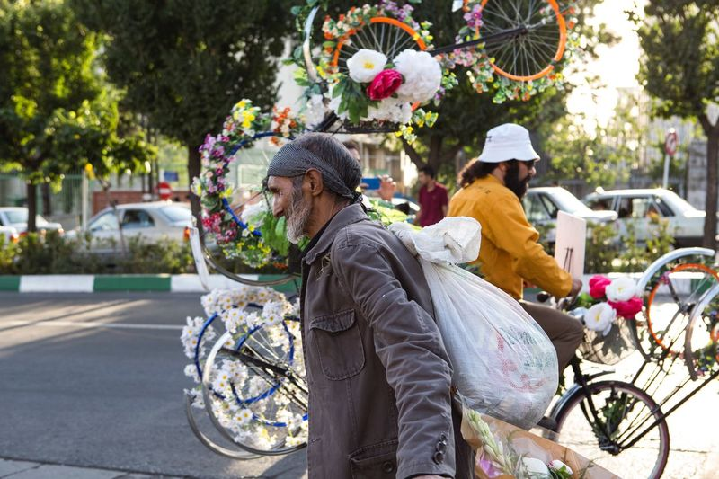 He searched on the garbage for finding something for eat and sell . But he had smile when he saw this bike. Bicycle Tehran, Iran Tehran