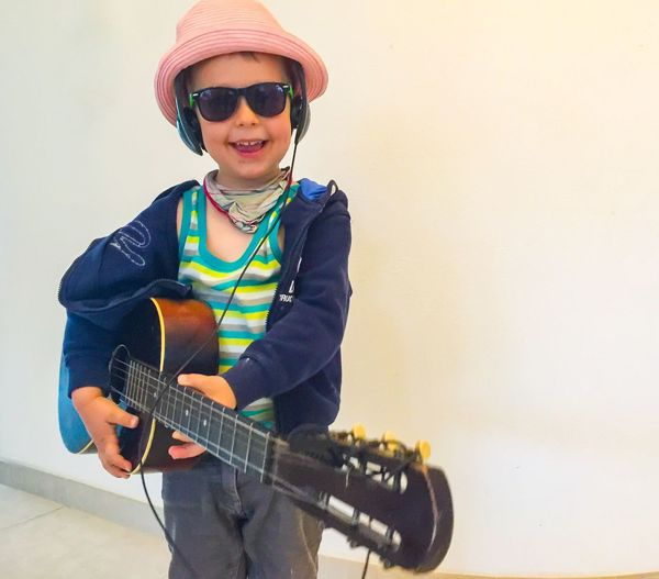 Cool guitar kid 😎🎸🎶 Cool Guitar Kid Music Funny Green Sunglasses Gitarre Spaß Spiel LovemusicMusical Instrument Playing Childhood Real People Leisure Activity One Person Casual Clothing Lifestyles Arts Culture And Entertainment Elementary Age Standing Boys Indoors  Musician Plucking An Instrument Day People