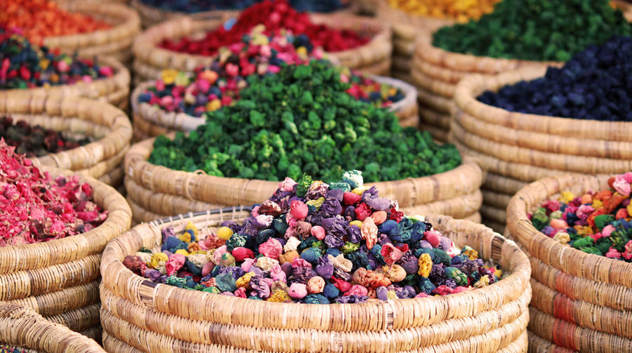 Close-up of multi colored spices for sale in market