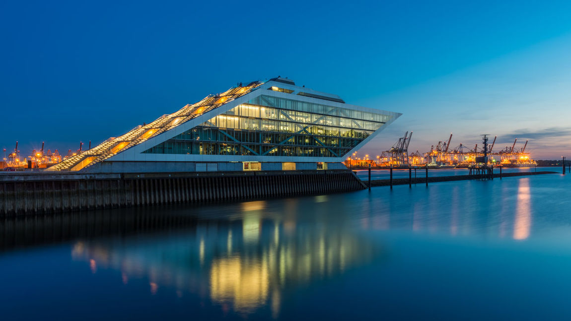 Dockland Hamburg Architecture Blue Built Structure Clear Sky Day Freight Transportation Illuminated Nature Nautical Vessel No People Outdoors Sky Transportation Water Waterfront