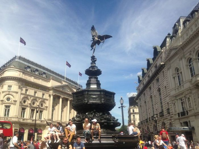 EROS. Summer Days Chilling In The City Picadilly Circus Eros Statue Eros London Tourists Relaxing Hanging Soaking Up The Sun Sunny Days Sunshine