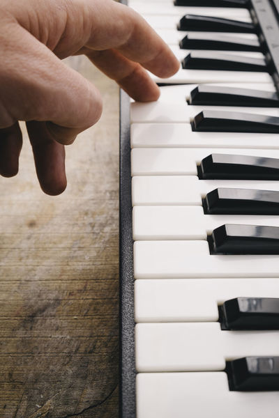 Keyboard synthesizer Black Buttons Close-up Composer Electro Human Body Part Instrument Key Keyboard Instrument Man Music Music Musical Instrument Note Piano Piano Piano Key Player Playing Song Songwriter Synthesizer Technology White Wood - Material