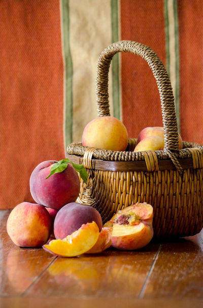 basket of fresh peaches against a fall background Agriculture Fall Colors Freshness Nature USA Basket Close-up Container Food Food And Drink Freshness Fruit Group Of Objects Healthy Eating Indoors  Juicy Fruit Michigan Peaches Orange Color Organic Peanuts Peach Still Life Table Wellbeing Wood - Material Yellow
