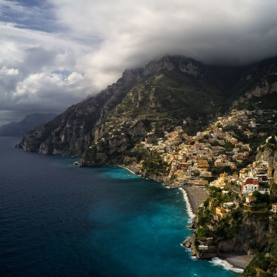 Positano village, made by drone Rural Scene Amalfi Coast Italy Italian Riviera Italianeography Castle In The Sky Mountains And Sky Drone  Tree Water Mountain Sea Beach Beauty Aerial View Cliff Blue Pinaceae Coastline Horizon Over Water Rocky Coastline Coastal Feature Mountain Peak Steep Seascape Ocean Coast Shore Stack Rock Foggy