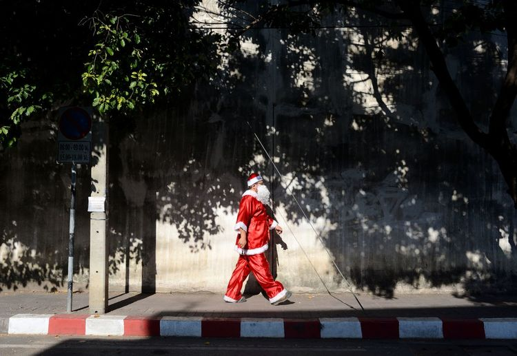 Santa Claus Walking On Footpath