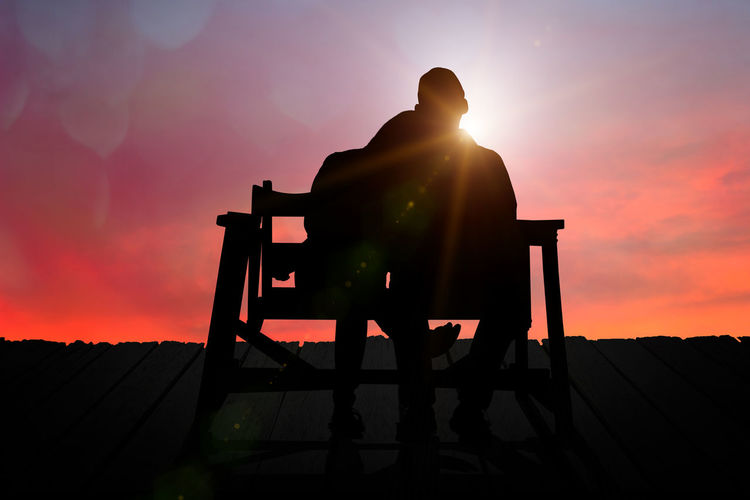 Couple watching the sunset on Valentine's Day. Couple View Love Honeymoon Silhouette Orange Color Sunset Real People Sunlight Lifestyles Sun Lens Flare Picturesque Scenics Happy People Happy Time Adult Valentines Watching Young Adult Happiness Romantic Attractive Two People Boyfriend