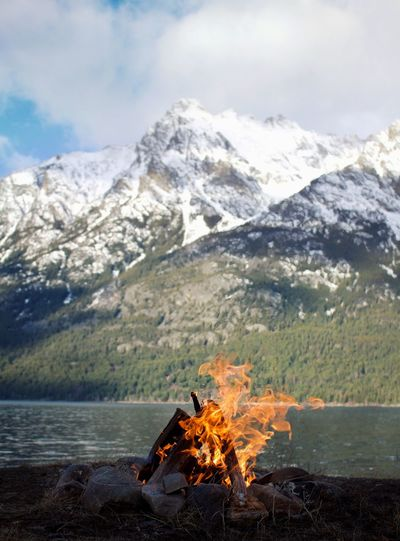 Early morning camp fire overlooking Nuit Beauty In Nature Day Flame Heat - Temperature Landscape Mountain Mountain Peak Mountain Range Nature No People Outdoors Scenics Sky Smoke - Physical Structure Snow Water Winter