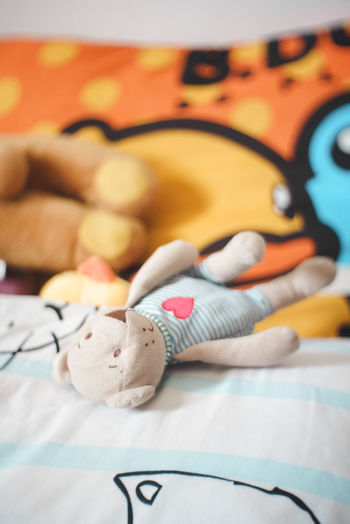 Close-up of toys on bed