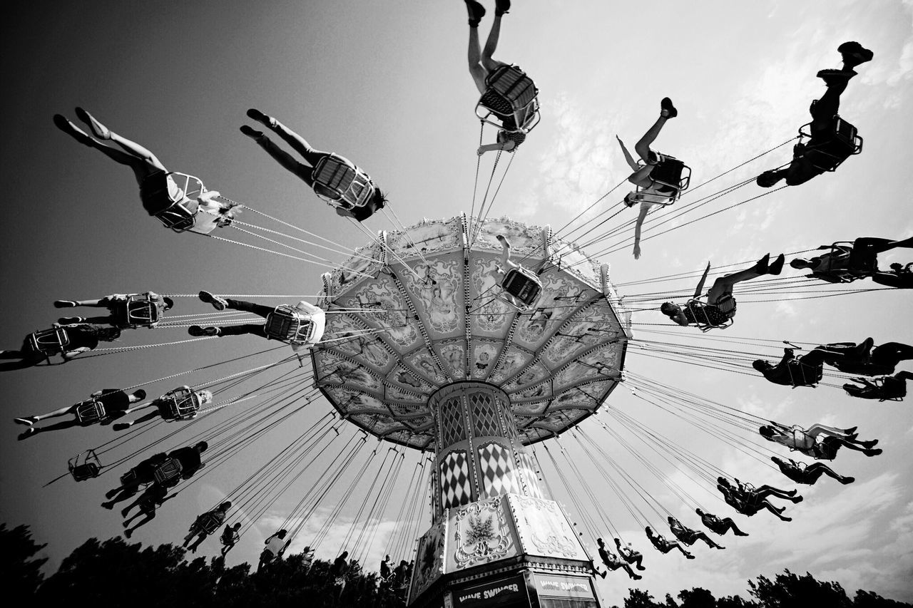 Low Angle View Of Swing Ride Against Clear Sky