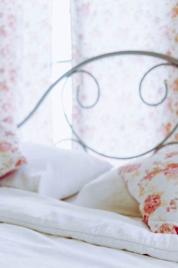 Close-up of eyeglasses on bed