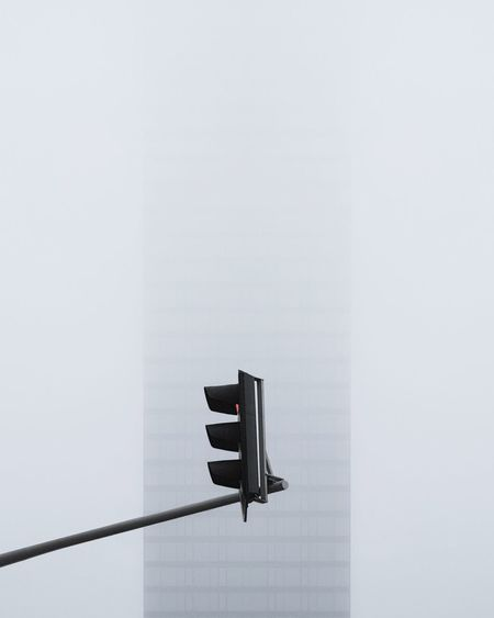 Low angle view of traffic signal against building