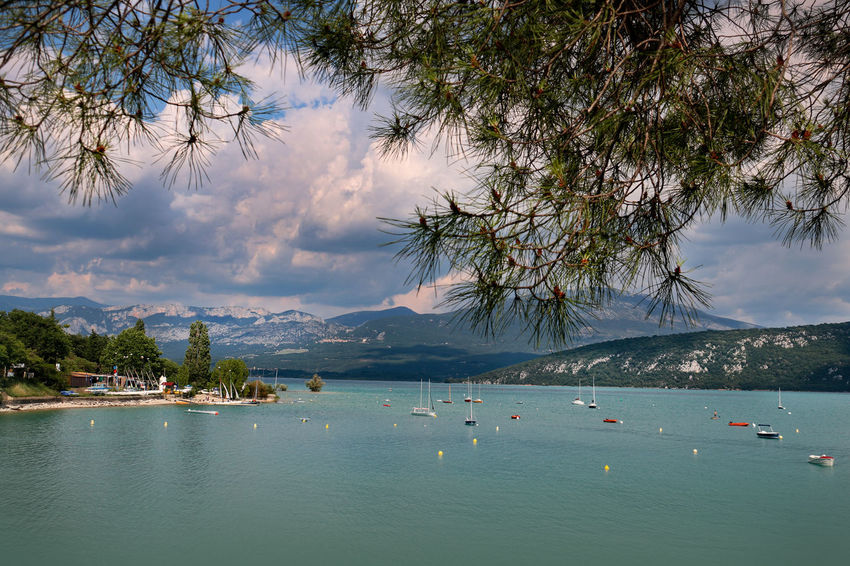 Lake of the Holy Cross Beauty In Nature Cloud - Sky Day Gorges Du Verdon Lake View Mode Of Transportation Mountain Mountain Lake Nature Nautical Vessel No People Outdoors Scenics - Nature Sky Thunder Clouds Tranquil Scene Tranquility Transportation Travel Tree Water Waterfront Yacht