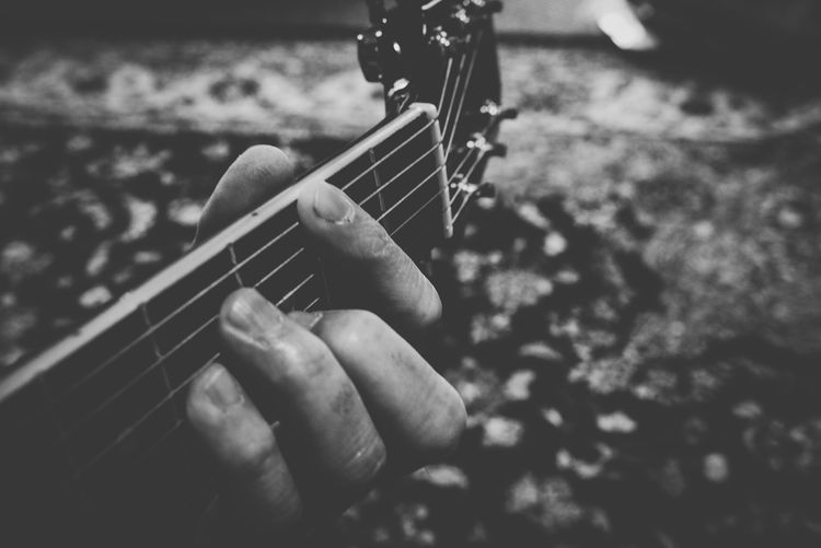 Fret Board Guitar Neck Guitar Strings Guitar Rug Black And White Obsession Black And White Phase Black And White Collection  Black And White Photography Black And White One Person Real People Plucking An Instrument Arts Culture And Entertainment Fretboard Leisure Activity Holding Focus On Foreground Lifestyles Indoors  Close-up Small Business Heroes