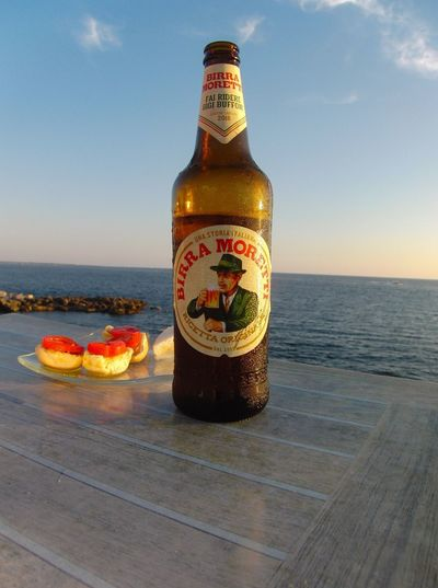 "Commercialblog ""Moretti ! Italy Beer"" Sea Sky Water Food And Drink Container Bottle Horizon Over Water"