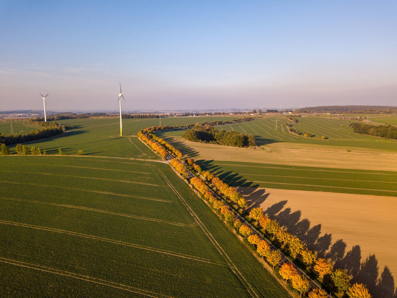 environment, landscape, sky, field, scenics - nature, beauty in nature, land, tranquil scene, rural scene, nature, tranquility, wind turbine, turbine, agriculture, day, renewable energy, no people, green color, environmental conservation, outdoors, sustainable resources