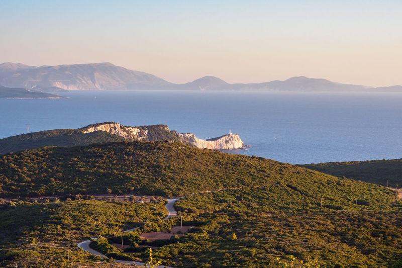 Cape Lefkada Lighthouse Cape  Lefkada Greece Greek Islands Ionian Sea Ionian Islands EyeEm Selects Sea Sunset Hill Water Sky Landscape Shore Horizon Over Water