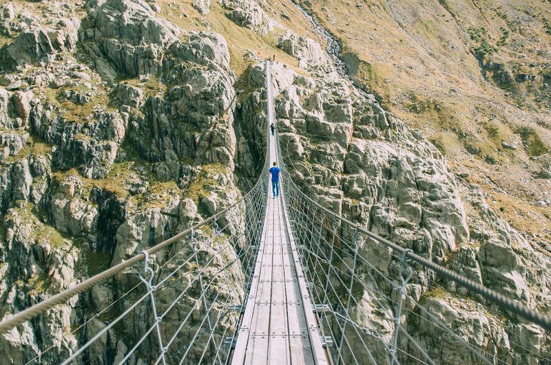 Rope bridge over rocks