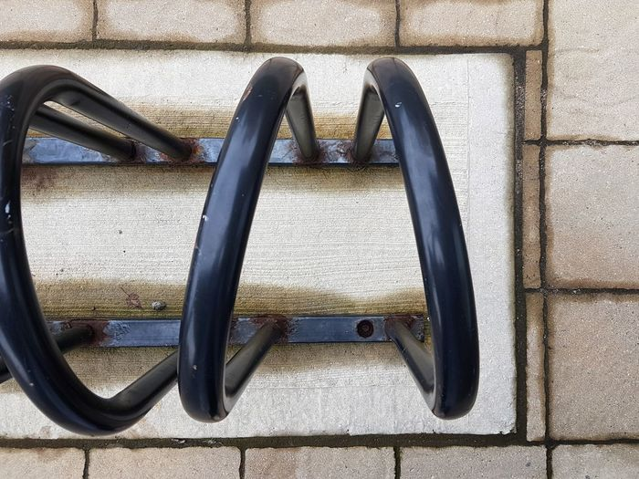 High angle view of metal hanging on wall