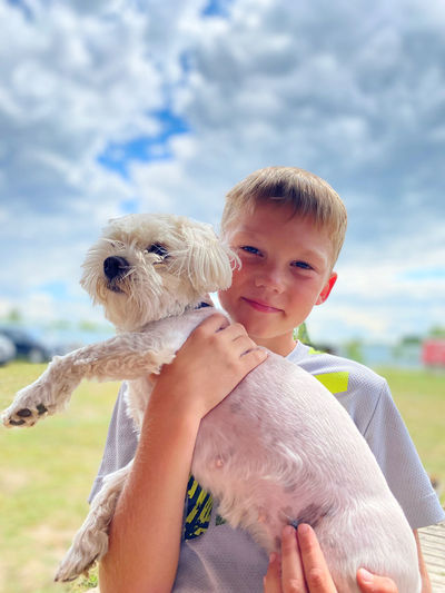 Portrait of boy with dog