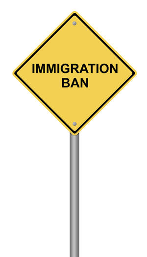 Yellow warning sign with the text Immigration Ban. Admission American Blocked Country Discrimination Entry Extreme Government Illustration Immigration Immigration Ban Law Legality National Order Political Road Sign Security Sign Symbol Text Vetting Warning White Background Yellow