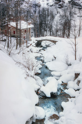 Snow Cold Temperature Winter White Color Nature Built Structure Beauty In Nature Bare Tree No People Architecture Covering Frozen Water Tree Day Building Building Exterior Plant Scenics - Nature Mountain Italy EyeEmNewHere EyeEm Best Shots EyeEm Nature Lover Landscape