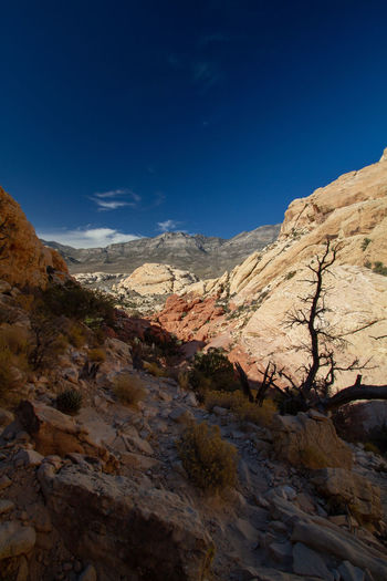 Scenic view of rocky mountains against blue sky. red rock canyon, nevada