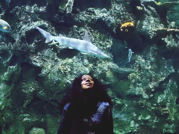 Young woman in aquarium