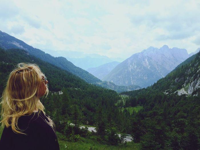 Woman looking at mountains in kranjska gora