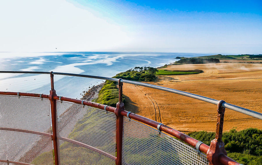 Water Sea Sky Railing Nature Day Scenics - Nature Horizon Over Water Barrier Horizon Boundary Cloud - Sky Land Fence Beauty In Nature Outdoors One Person Metal Leisure Activity