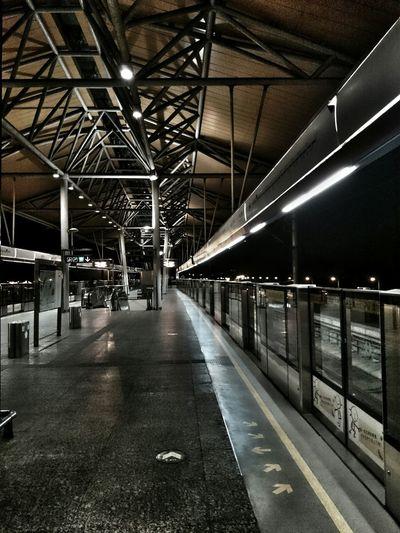 Empty railroad station platform at night