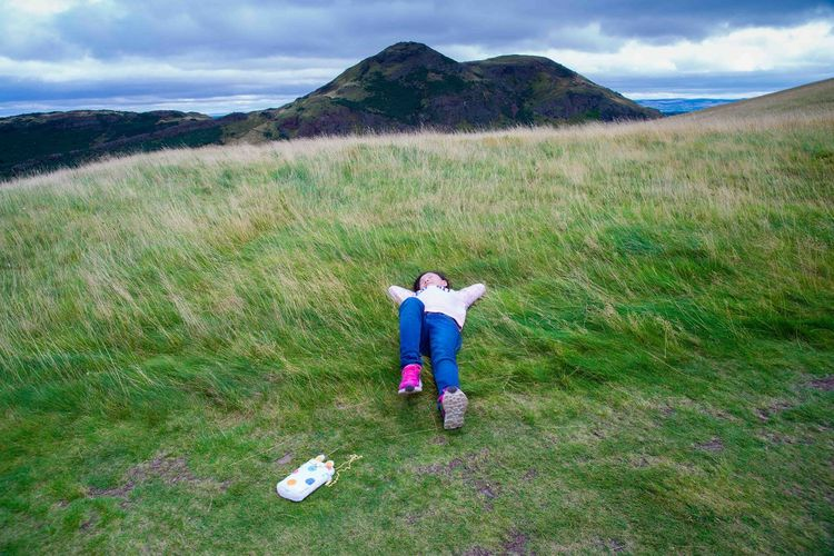 Dreaming in Meadow and Wind Authur's Seat Dreaming Edinburgh Holyrood Park Travel Attraction Bag Girl Hill Hilltop Lying Down Meadow Mountain Outdoor Sky Sleeping