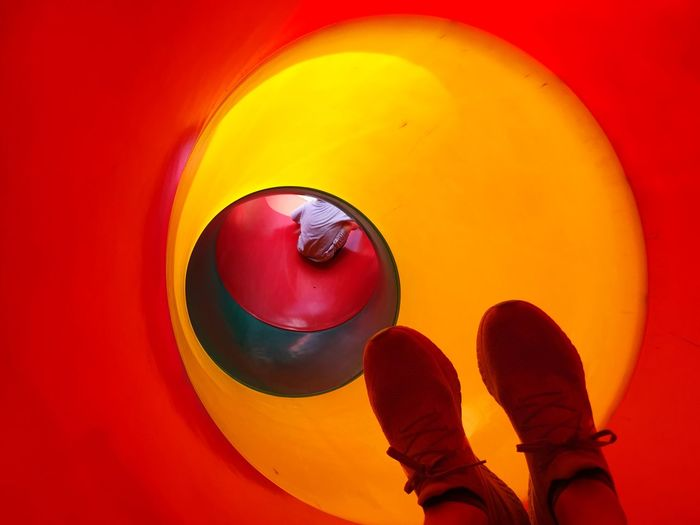 Going down the slide Boy Slide - Play Equipment EyeEm Selects Human Body Part Body Part Shoe Red Personal Perspective Circle Orange Color Lifestyles Leisure Activity Human Leg Real People
