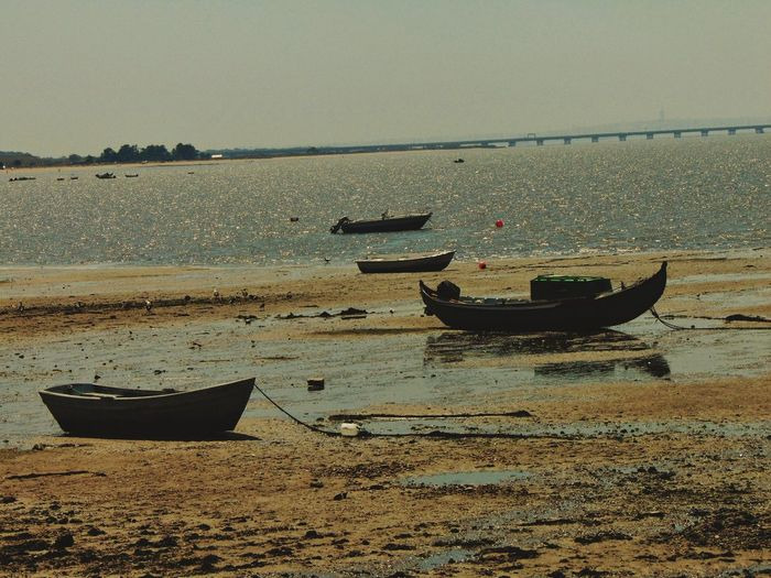 Nautical Vessel Beach Sand Sea Water Rowboat Transportation Moored Tranquility Outdoors No People Horizon Over Water Nature Day Sky
