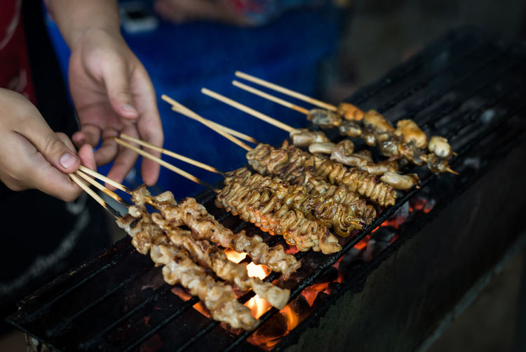 High angle view of preparing food on barbecue grill
