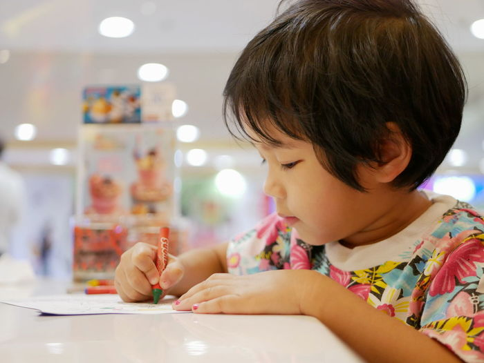 Little Asian baby girl learning to grasp a crayon and do painting by herself Baby Girl Asian  Learn Little Young Grasp Hold Crayon Crayons Sit Drawing Coloring Painting Child Kid Toddler  Asian  Development Develop Skill  Fun Enjoy Happy Concentrate