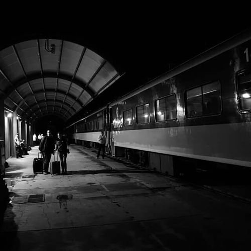 Railroad Station Travel Indoors  Reflection Railroad Station Platform Public Transportation Architecture Rail Transportation City Real People Built Structure Men People Subway Train Adults Only Adult Day