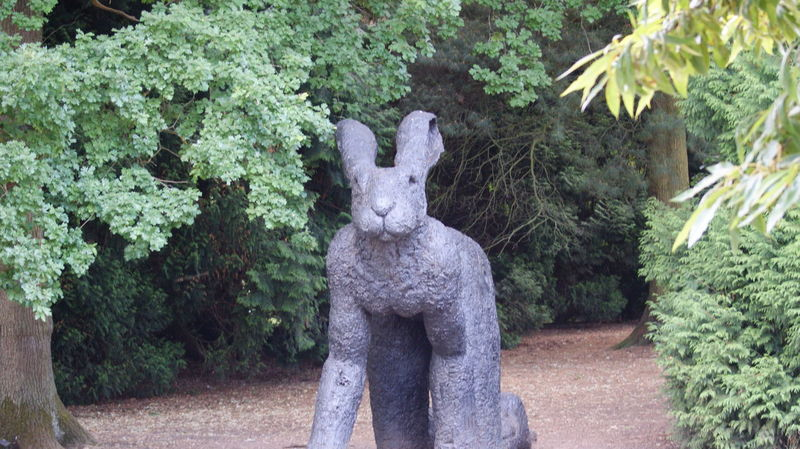 Animal Animal Representation Animal Themes Art And Craft Creativity Day Focus On Foreground Green Color Growth Mammal Nature No People Outdoors Park Park - Man Made Space Plant Rabbit Representation Sculpture Statue Tree
