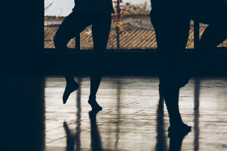 Low section of silhouette people in dance studio